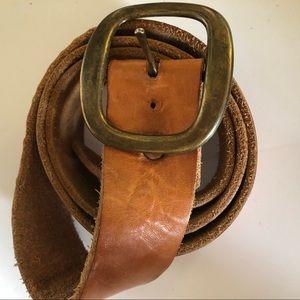 Handmade vintage genuine leather belt in saddle
